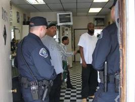 Officers visit a barber's shop in Camden.