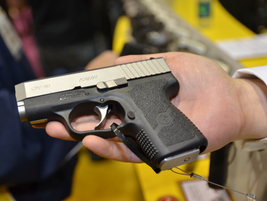 The Kahr Arms CM40 polymer subcompact pistol delivers more punch to concealed carriers seeking a...