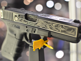 """The Glock """"Statue of Liberty"""" G22 sold for $15,025 as the official show gun. The custom-engraved..."""
