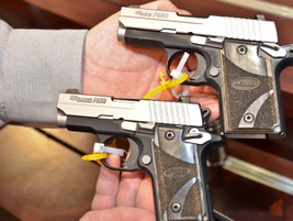 SIG Sauer brought the first working versions of its P938 pistol (above), a 9mm version of its...
