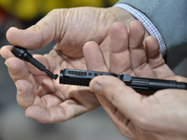 CampCo.'s UZI Tactical Pen now arrives with a handcuff key mounted inside the crenulated top.