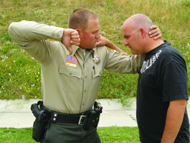 For an elbow strike, you must control and isolate the suspect's head. By orienting your hand...