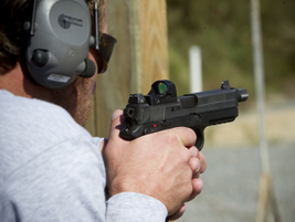 The FNX-45 Tactical includes a threaded barrel and Trijicon night sights.