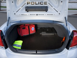 Officers gathered in the GM booth at IACP were also thrilled by the new car's trunk. It's...
