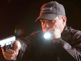 Neck Index—Draw your handgun and hold it in a one-handed grip, then draw your flashlight, grip...