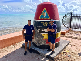 Miami officers at the famous Southernmost Point in Continental United States monument in Key...