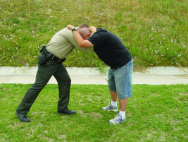 For the knee strike, first control the suspect's head so the suspect receives the full force of...
