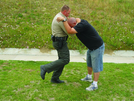 When throwing the knee strike, drive up and in  to the suspect's body. While doing so, shift...
