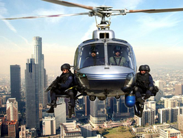 SWAT officers ride the aerial platform above downtown Los Angeles.