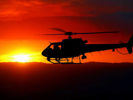 The setting sun provides a picturesque backdrop for an LAPD helicopter.