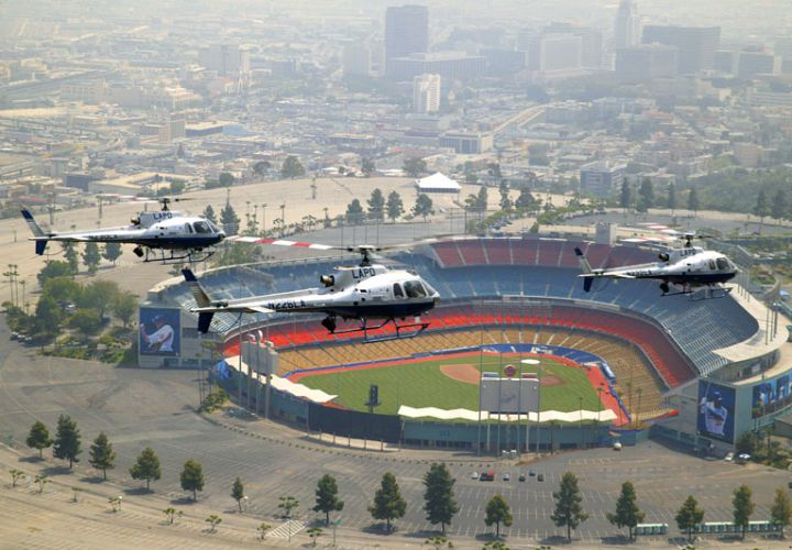 Three of the LAPD's American Eurocopter AS350 B2 helicopters patrol near Dodger Stadium.