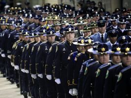 Nearly 20,000 officers from around the nation and Canada attended the memorial service for the...
