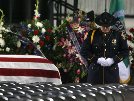 A casket guard maintains his position prior to the starting of the memorial service at the...