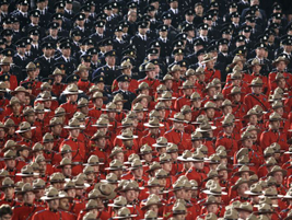 A contingent of Canadian mounties and other officers attended the memorial service for the four...