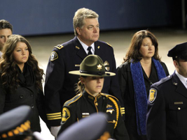 Lakewood Police Chief Bret Farrar attends Tuesday's memorial service at the Tacoma Dome for the...