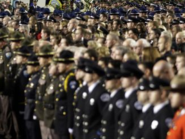 Following eulogies for the four slain Lakewood officers, mourners watched a video tribute to the...