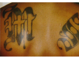 "This ""MS"" tattoo identifies its owner as a member in Mara Salvatrucha, a large Hispanic gang..."