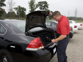An ergonomic evaluation is performed that considers trunk space for an officer's body armor,...