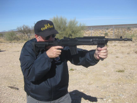 Using the iron sights can be difficult because the accessory rail partially blocks the...