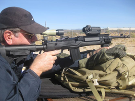The rifle is compatible with a wide range of optics, including the Aimpoint Comp M4 shown...
