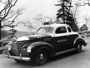The NYPD's 1938 Plymouth two-door radio car had a white nose, green hood, and white roof. Photo...