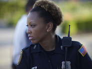 """Officer Virginia Awkward, according to TLC, """"understands the impoverished neighborhood she..."""
