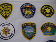 In states such as Colorado, sheriff's departments don't follow uniformity of design. Badge and...