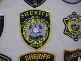 "The Montgomery County (Kan.) Sheriff's patch includes local references to the setting in ""Little..."