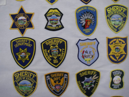 Most patches worn by Kansas deputies incorporate the star badge yet vary wildly in color, shape...