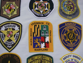 The Frederick County (Md.) Sheriff's Office incorporates images from the state flag in the upper...