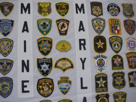 Sheriffs' patches in Louisiana, Maine and Maryland are shown on this panel.