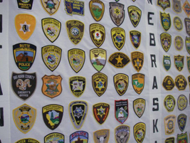 These panels show sheriffs' patches from Montana and Nebraska.