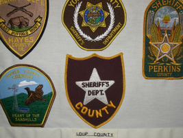 The Loup County (Neb.) Sheriff's Department has perhaps the most nondescript patch in the...