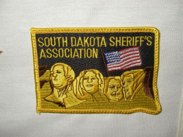 The South Dakota Sheriff's Association patch pays homage to the state's most famous national...