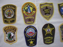 The Virginia sheriffs' patches caused an engineering challenge for the Shulls becuase they are...
