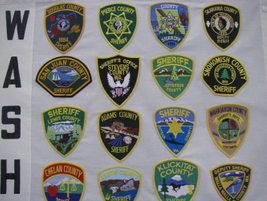 This panel shows the colorful patches of the state of Washington's sheriffs agencies.