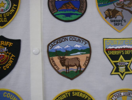 The Jackson County (Colo.) Sheriff's Office patch shows the natural sites of the state's...