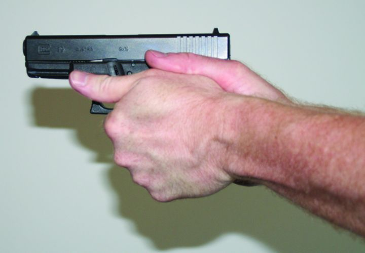 By placing your thumbs along the side of the pistol's slide, you are able to obtain that all...