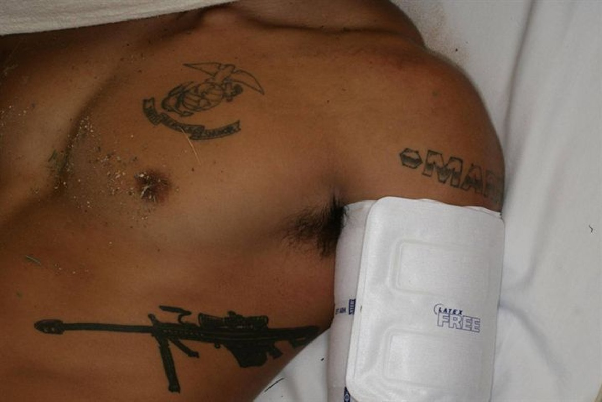 One of the marine suspects was a military trained sniper who sported a prominent tattoo of a...