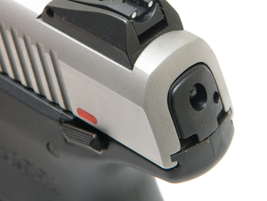 The SR40's rear sight is adjustable for elecation. The tail of the striker is visible when that...