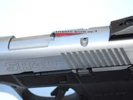 The loaded chamber indicator gives a visible and tactile indication of the pistol's condition.