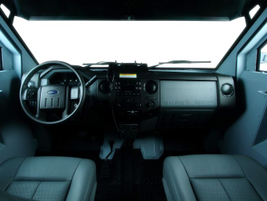 The Pit-bull VX's spartan cabin does include a PA system.