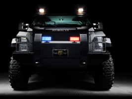 The Pit-bull VX from Alpine Armoring  strikes an imposing stance, and may help violators rethink...