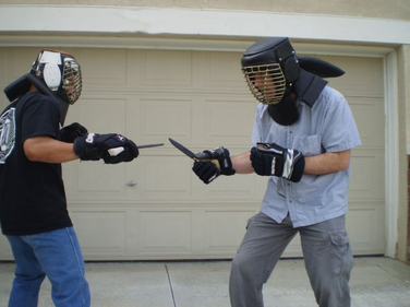 Practice knife-defense techniques using training knives and the appropriate protective gear....