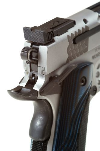 Contemporary features include lowered and flared ejection ports, skeletonized hammers, external...