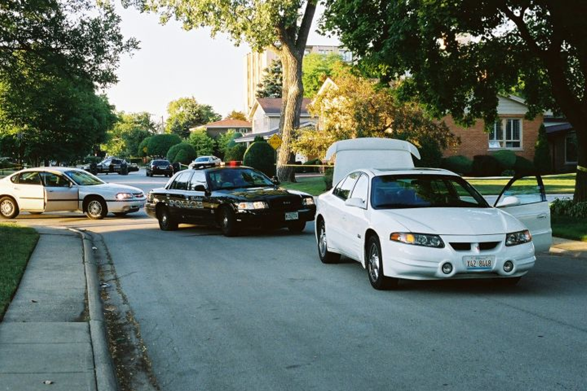 Officer Gramins pursued Maddox into a residential neighborhood, after identifying the white...