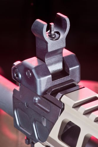 The front back-up iron sight retracts down.