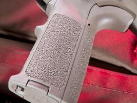 A Magpul pistol grip improves ergonomics.