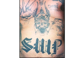 """This tattoo depicts a Viking death's head images and """"SWP,"""" which refers to """"Supreme White..."""