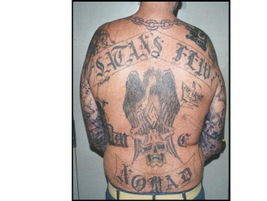 This gang tattoo reveals that the wearer is a member of the outlaw motorcycle gang Satan's Few....